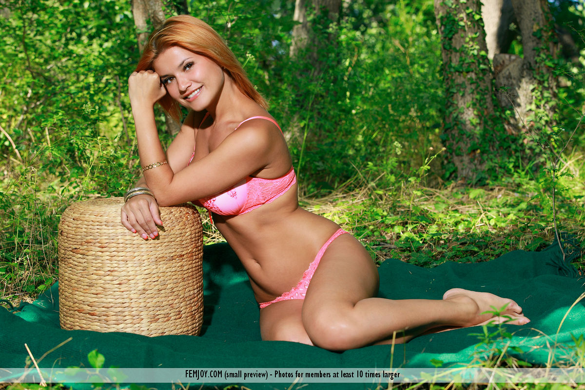 Femjoy - Horny babe Dina P takes off her pink lingerie in the woods 1