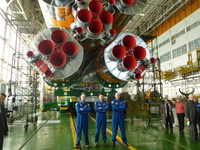 Soyuz TMA-03M posing with their launcher
