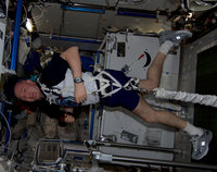 ESA astronaut André Kuipers exercising on the ISS