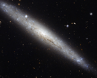 Hubble portrays a dusty spiral galaxy