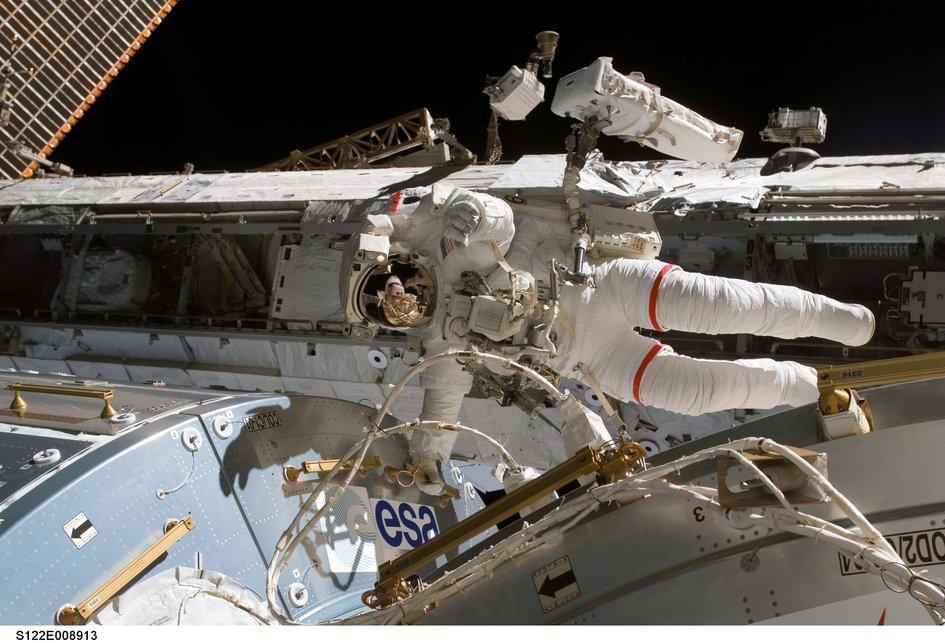 NASA Astronaut Rex Walheim hanging on to Columbus