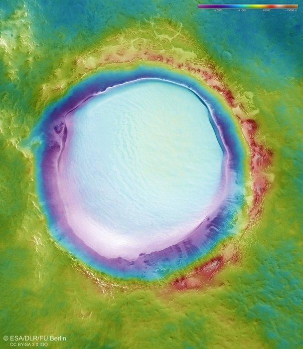 Imagini pentru A topographic map of Korolev crater.