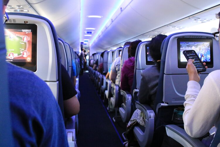 Passengers using devices on board a plane