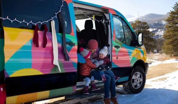 Campervan with Christmas lights and Mom