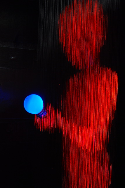 alessandro-lupi, red figure, blue bulb