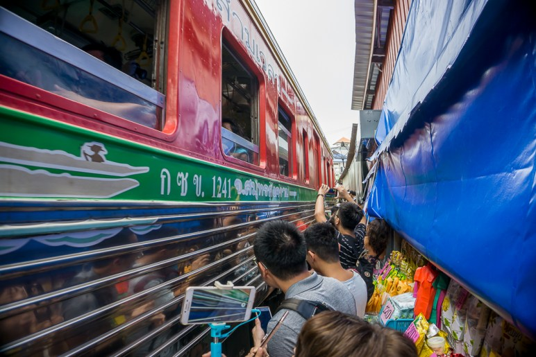 Visiting Bangkok and looking for the best day trip to do from the city? If you love exploring markets then you cannot miss visiting the Maeklong Railway and Amphawa floating market! I took a day tour there with a brilliant company called Trazy who offer the best discount tours all around Asia. Find out here why I loved it so much and what you can expect on this tour with Trazy #trazy #bangkokdaytrips #maeklongrailwaymarket #amphawafloatingmarket #visitthailand #bangkokmarkets #floatingmarkets