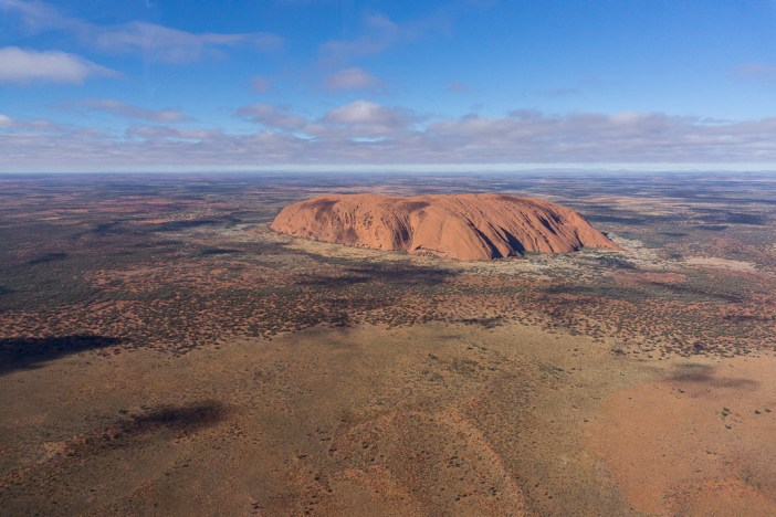 Planning a road trip to Uluru? It might be a seriously long way to drive but it's so worth it! Here's my guide on how to spend 3 days in Uluru and everything you need to know about visiting. #uluru #northernterritory #australiaredcentre #roadtripaustralia #campervanaustralia #visitaustralia #backpackingaustralia #australiaonabudget
