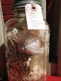 old mason jar filled with vintage lace, thread
