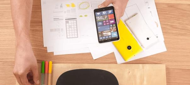 desktop computer and phones