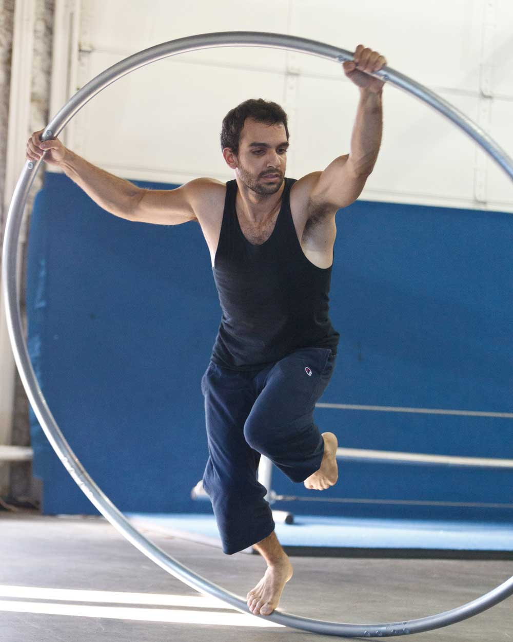 man training on cyr wheel