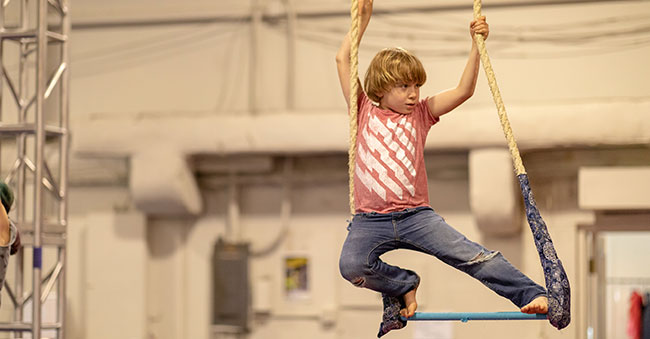 young boy on trapeze