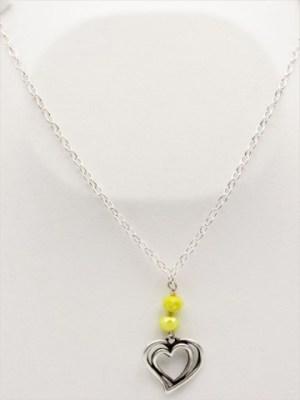 Χειροποίητο Κολιέ μακρύ με ασημί αλυσίδα και καρδιά με κίτρινα και μπεζ κρυσταλλάκια.