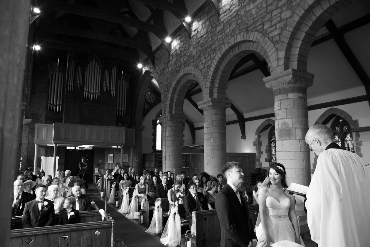 Wedding Ceremony at Chaddesley Corbett Church bride and goom laugh