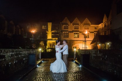 bride and groom night portrait fire coombe medieval glamorous rustic