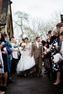 bride and groom confetti vintage relaxed wedding coombe abbey wedding ceremony st john baptist Wolvey