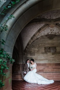coombe abbey archway bride and groom portrait natural relaxed glamour hollywood