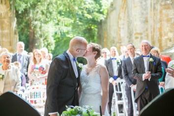 kiss bride groom outdoor ceremony ettington park hotel