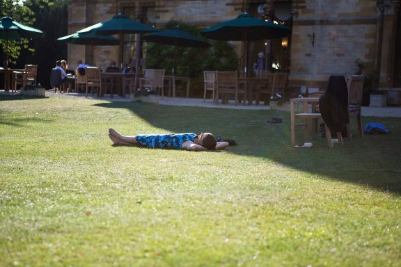 guest relaxes lieing on the grass