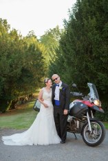 bride and groom with moterbike at relaxed cool wedding