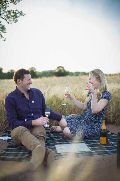 couple planing scrabble rustic pre wedding shoot corn field