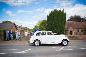 documentary guests waving bride groom goodbye