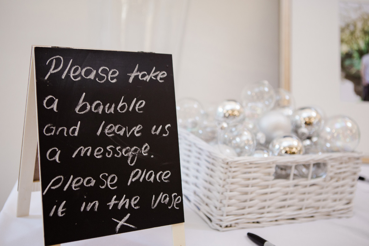 Winter wedding idea, write a message to the bride and groom on a bauble