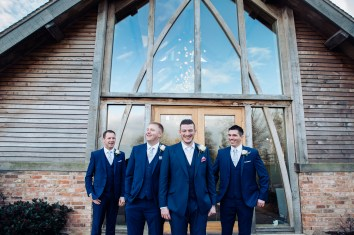 Groom and Groomsmen in blue suits Winter Wedding Mythe Barn Warwickshire