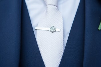 Groom snowflake tie pin blue suit winter wedding Mythe Barn Warwickshire