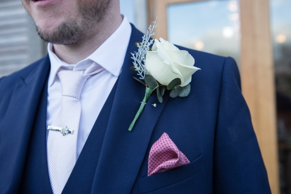 grooms winter wedding blue suit white rose Mythe Barn