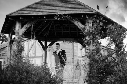 bride and groom in gazebo Winter Wedding Mythe Barn Warwickshire