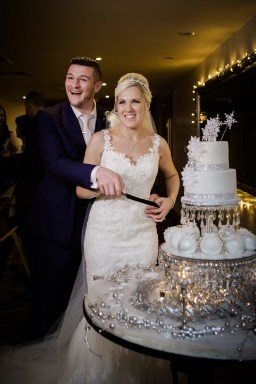 cutting the cake snowflake Winter wedding at Mythe Barn Warwickshire