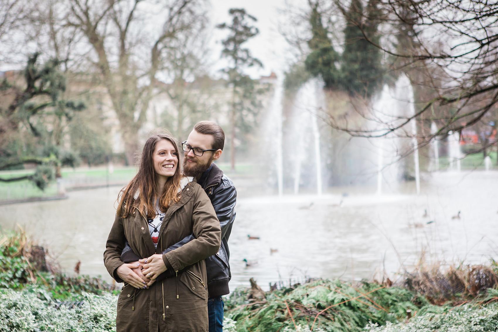 cute couple cuddle fountain pre wedding shoot pond jephson gardens