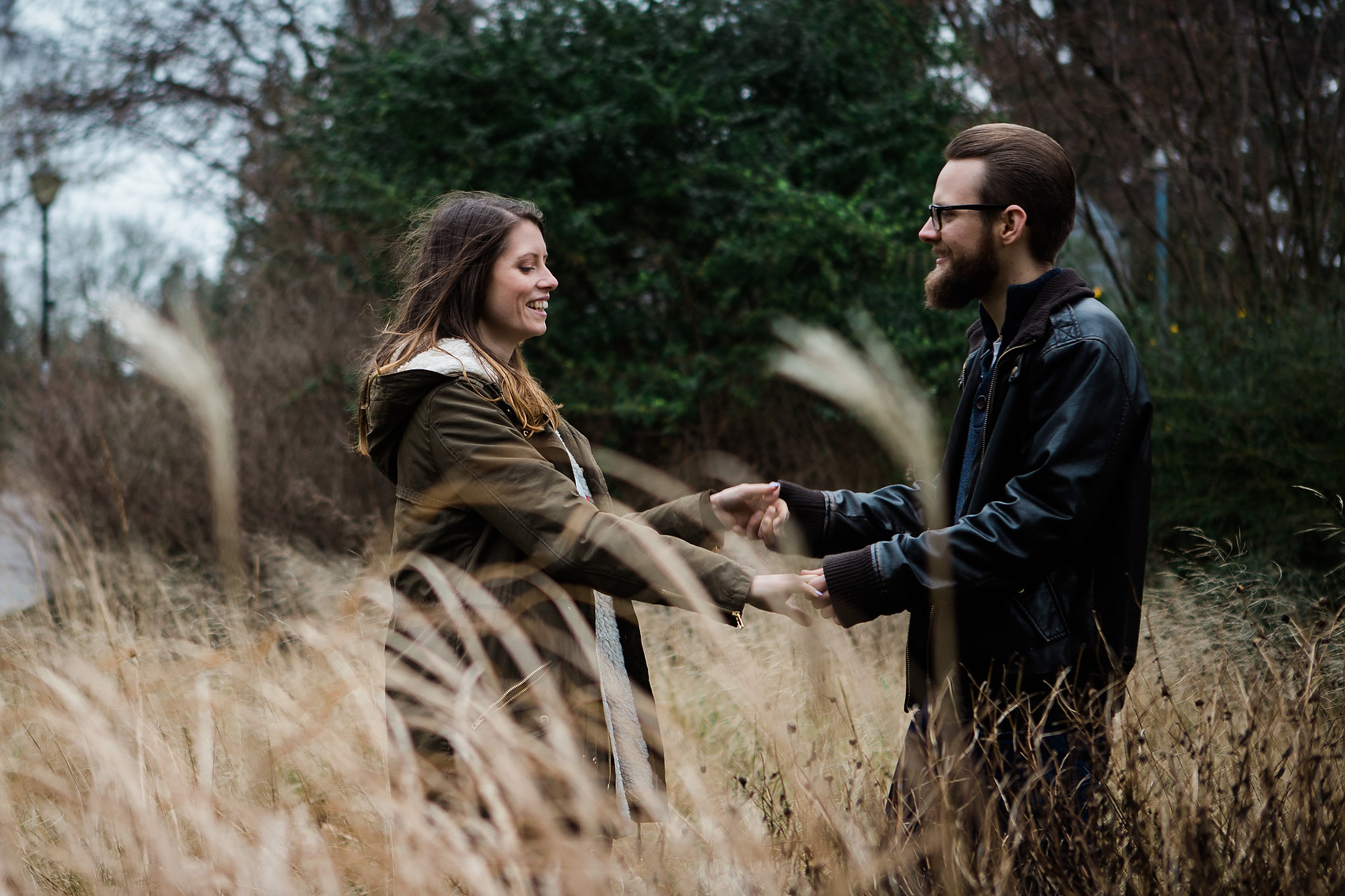 couple in long grass leamington spa stormy pre wedding shoot