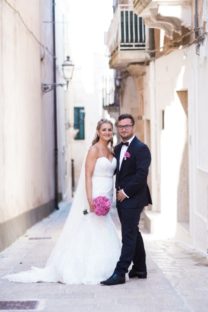 Bride and Groom in streets ceglie messipica South Italian Wedding