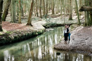 couple kiss next to river at Pre Wedding Shoot Coombe Abbey
