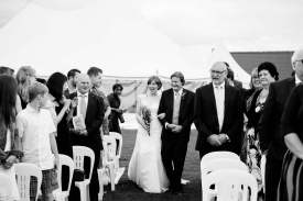 bride walks down aisle outdoor ceremony