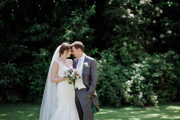 bride and groom portraits in gardens at pendrell hall