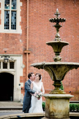 bride and groom kiss with fountain pendrell hall