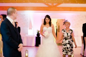 Bride Sees groom walking down aisle wedding ceremony