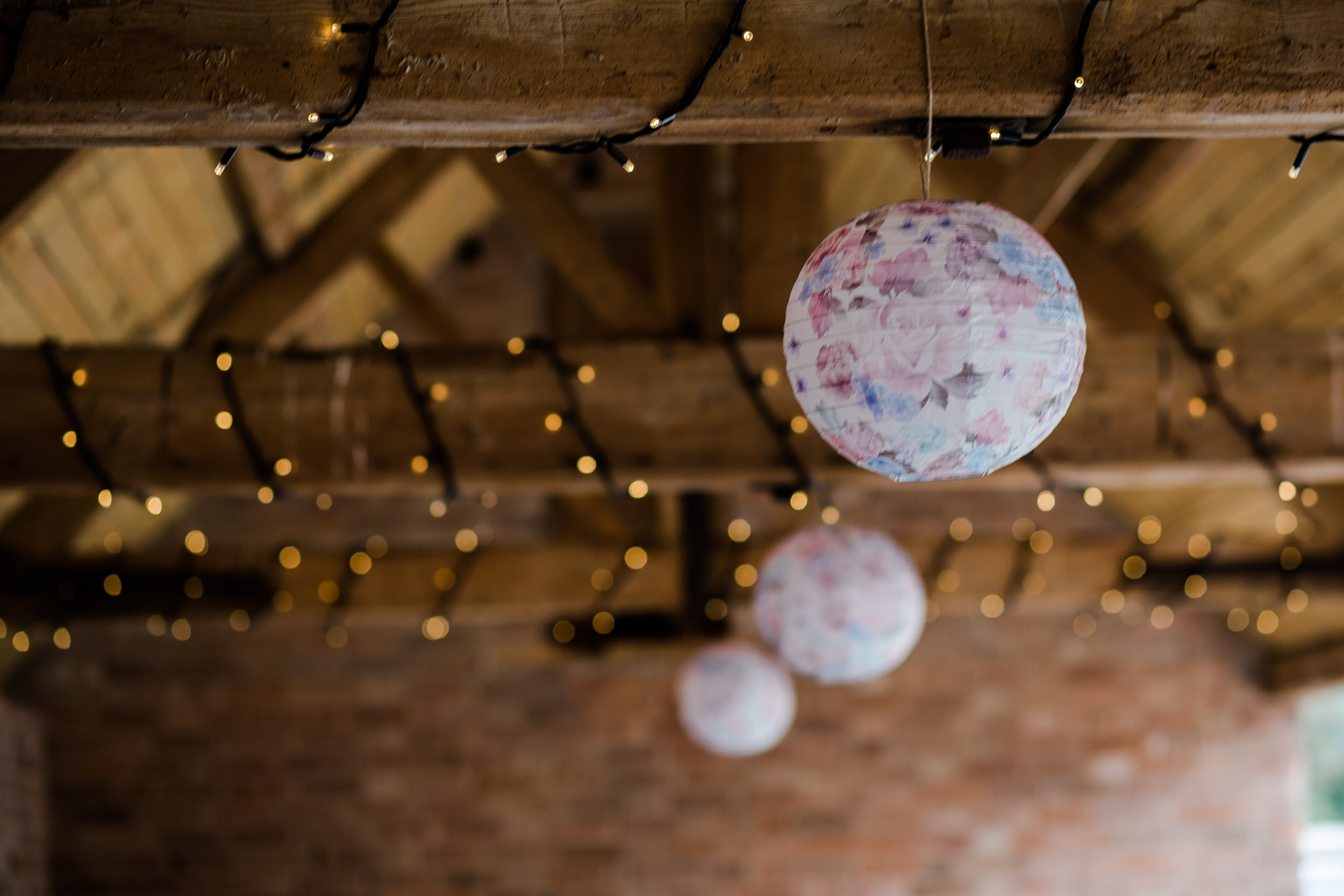 fairy lights and floral lanterns wedding decor