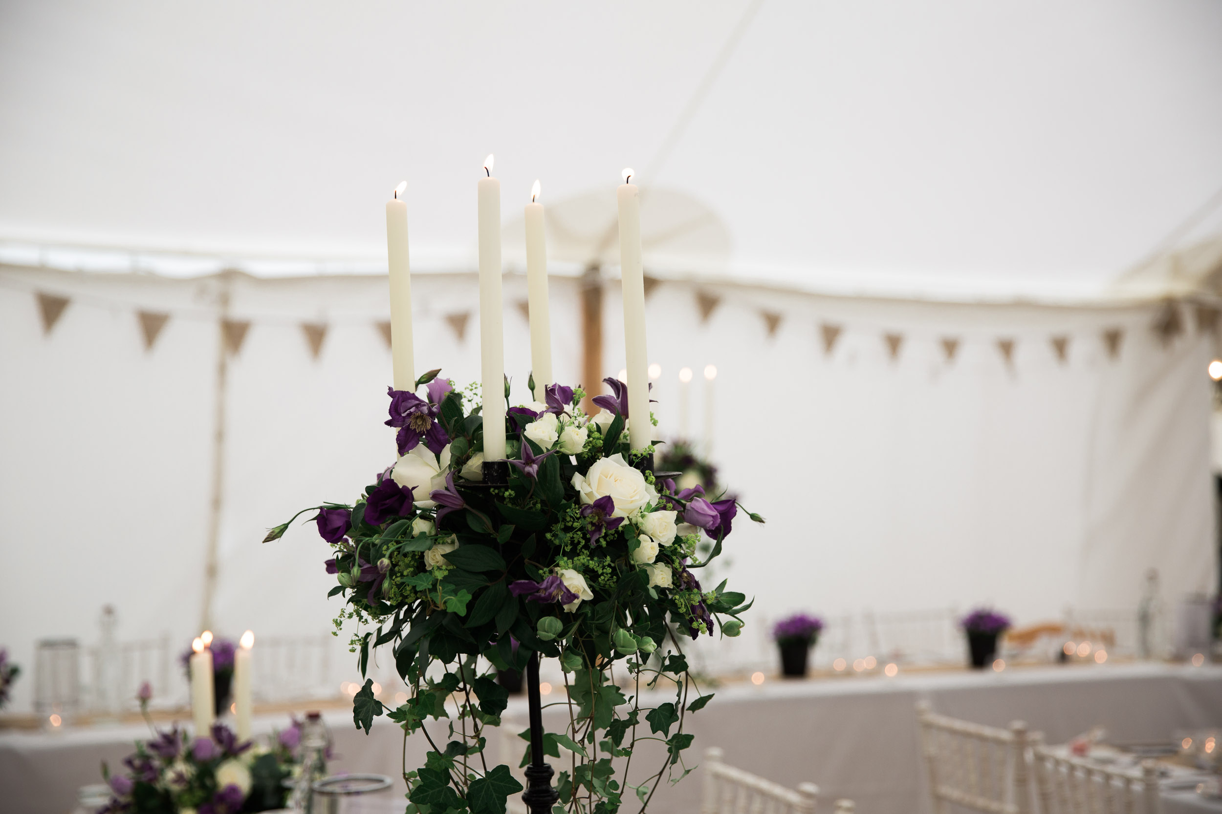 purple and white flowers candelabra wedding decor