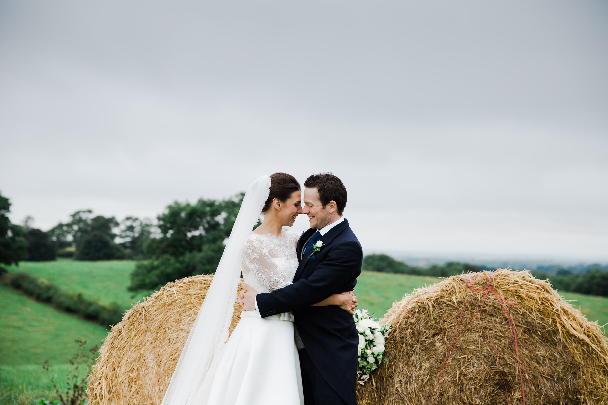Bride and Groom Portrait with hay bales and country views