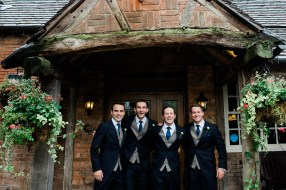 Groom and groomsmen at dunn cow
