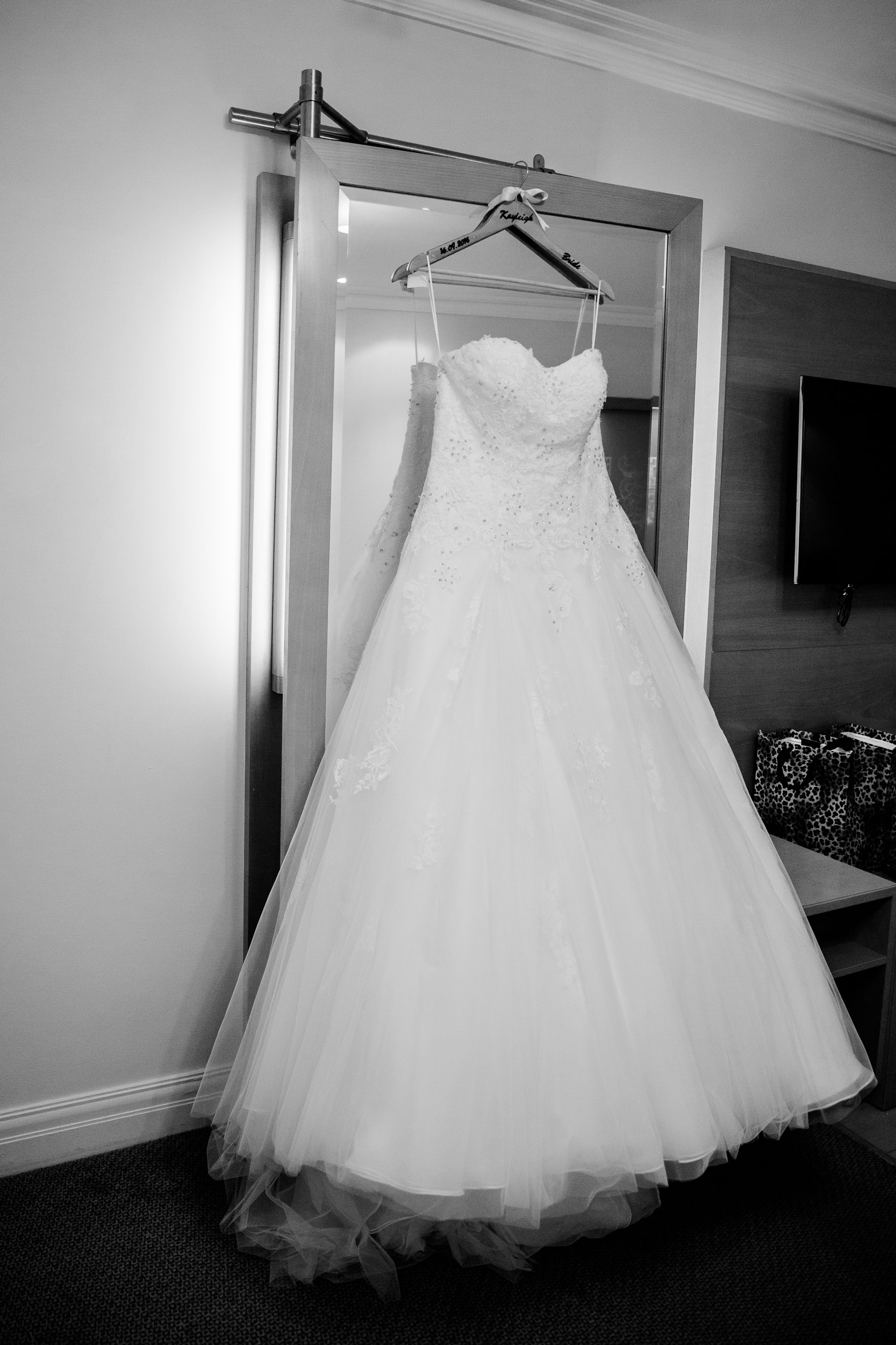 Brides Dress handing in hotel room Chesford Grange Hotel