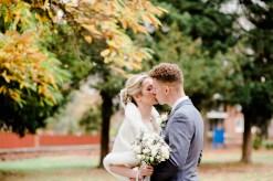 autumn wedding couple fur cape autumn wedding in warwickshire