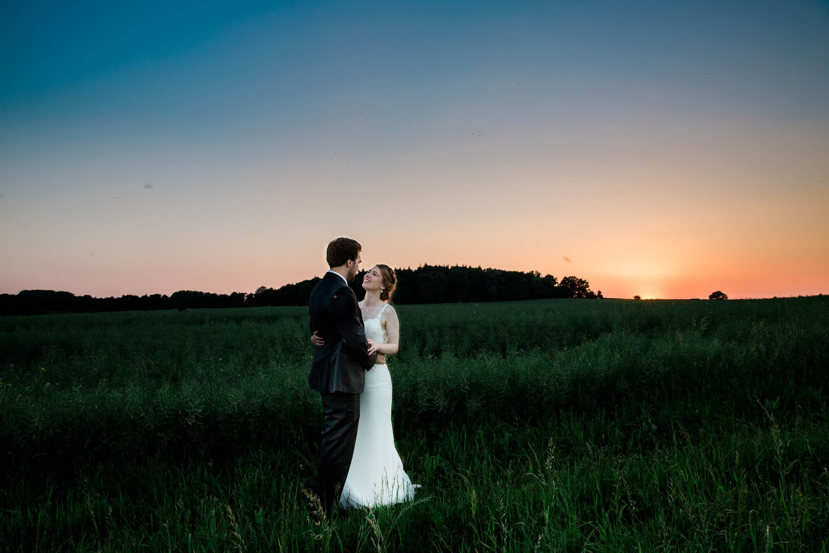 Modern Stylish Wedding at Swallows Nest Barn Couple Portrait Sunset