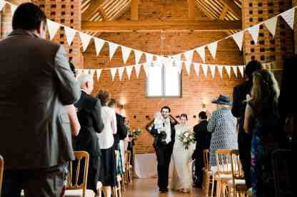 just married bride and groom swallows nest barn warwickshire