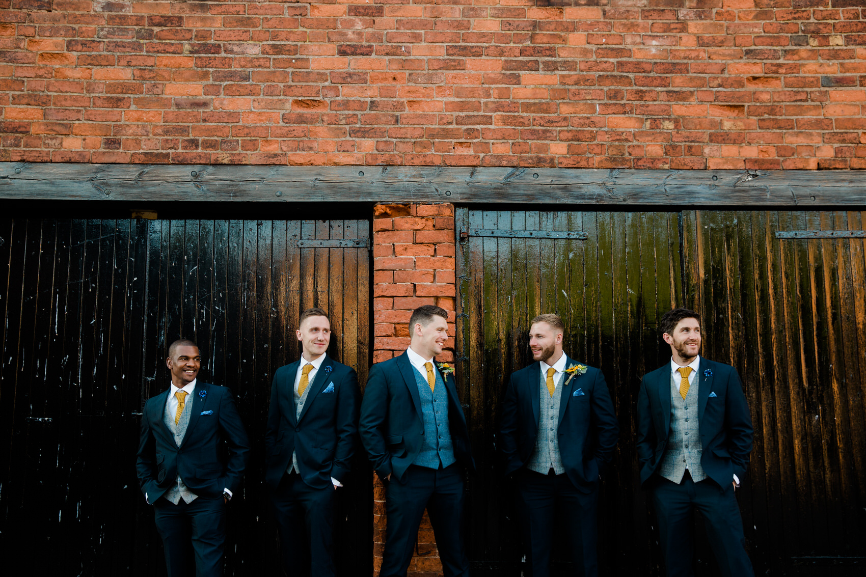 groom and groomsmen with blue and yellow colours
