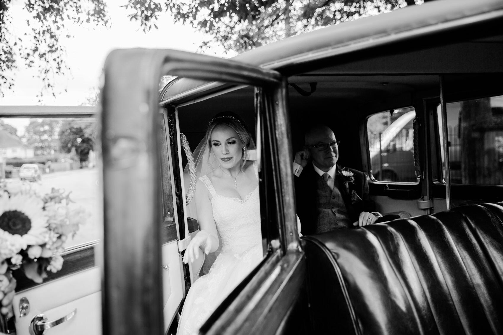 bride leaving car arriving at wedding