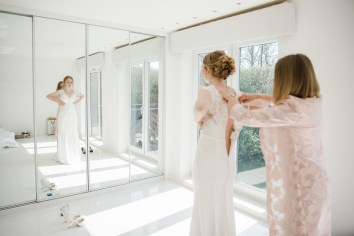 bride and mother of bride putting on wedding dress wedding morning leamington spa natural relaxed wedding Leamington Spa Relaxed Church reportage photography